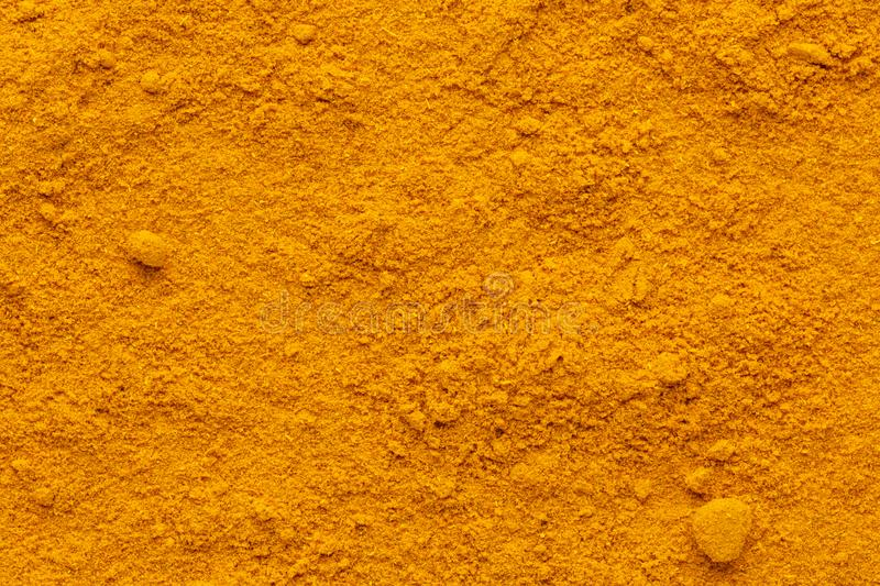 Curry powder ground full frame rough surface. Curry powder ground full frame image background with rough surface, view directly from above royalty free stock photography