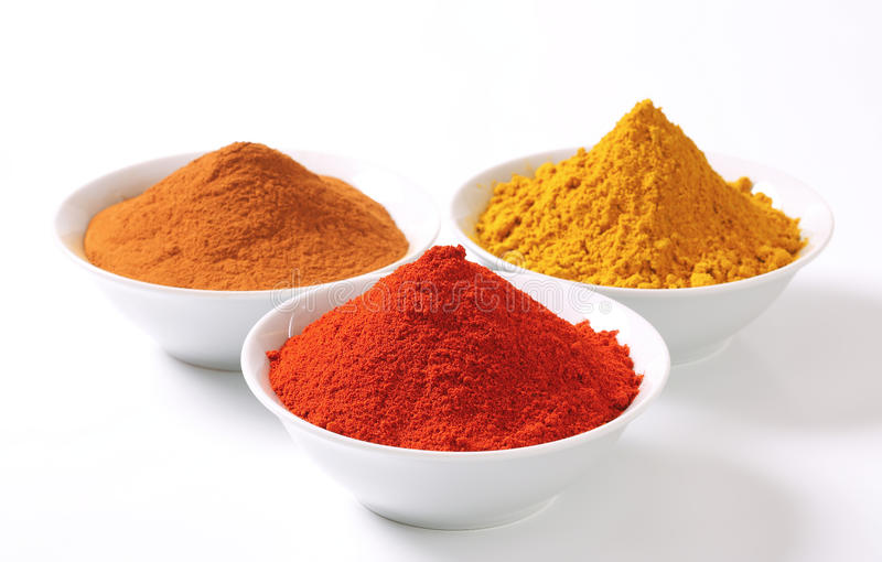 Curry powder, paprika and ground cinnamon royalty free stock photo
