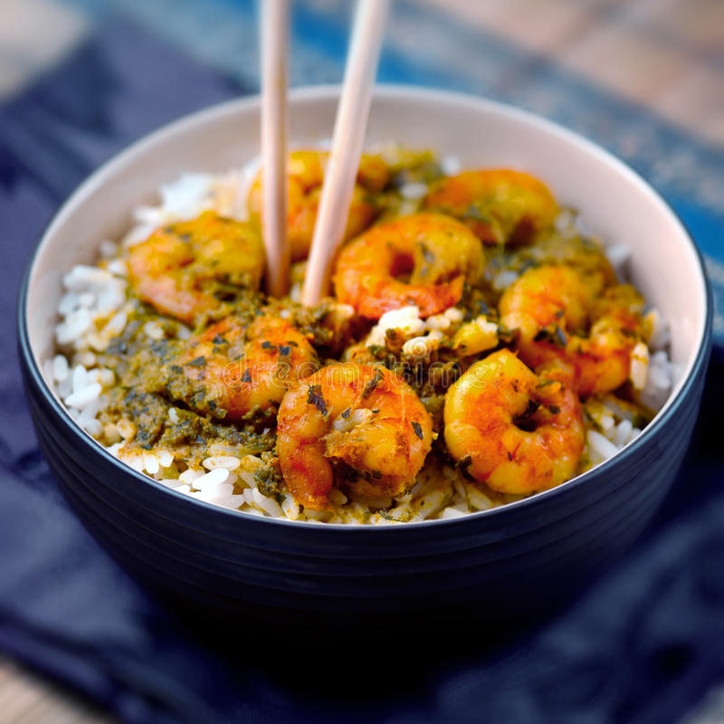 Curry prawns shrimp and rice in a bowl Caribbean food royalty free stock photo