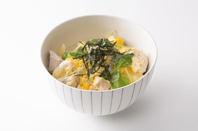 Curry ramen bowl with seaweed, pork, egg, cabbage and herbs on stock image