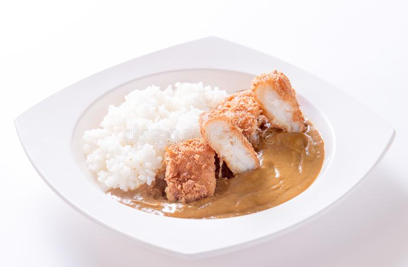 Curry with rice. On plate stock photography