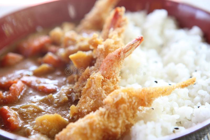 Curry rice with fried shrimp. In close up royalty free stock photography