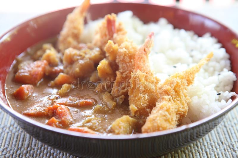 Curry rice with fried shrimp. In close up royalty free stock images