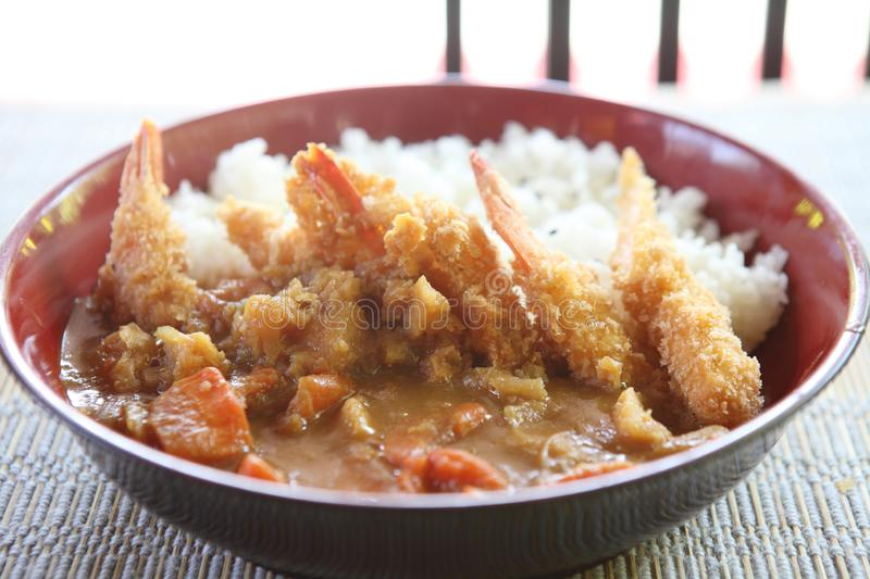 Curry rice with fried shrimp. In close up royalty free stock photo