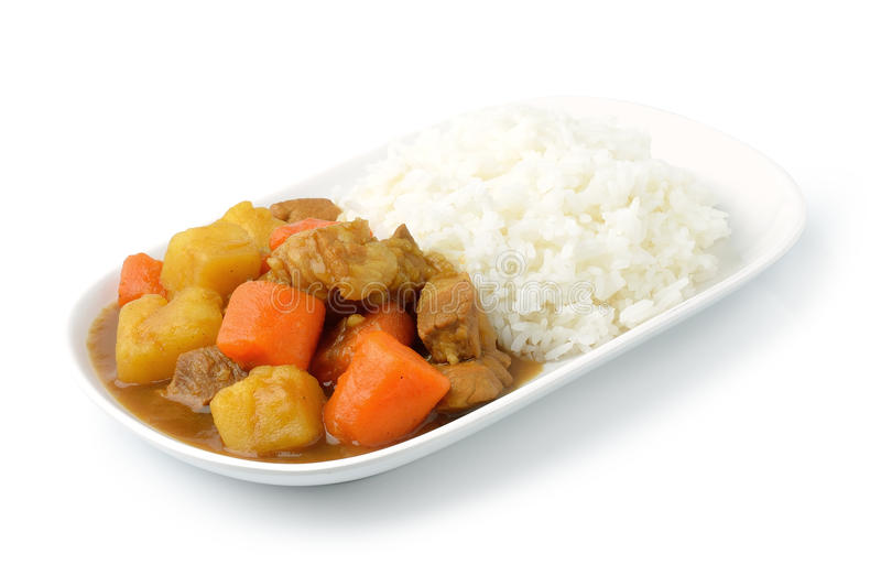 Curry and rice. Isolated on white stock images