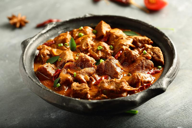 Curry Roasted mutton,lamb meat with traditional Indian recipes. Homemade Indian recipes- lamb,mutton curry roast ,slow cooked in clay pottery stock image