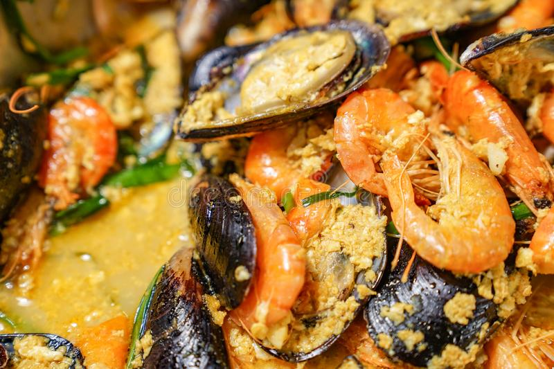 Curry shrimp and Mussel in the international line buffet royalty free stock images