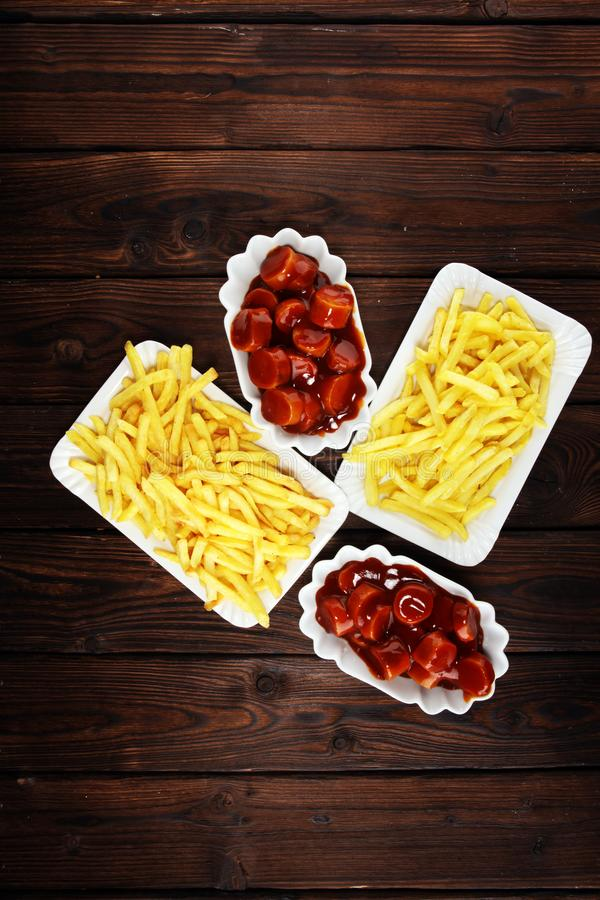 Currywurst with fries. traditional german food with sausages and curry. And fries stock photo