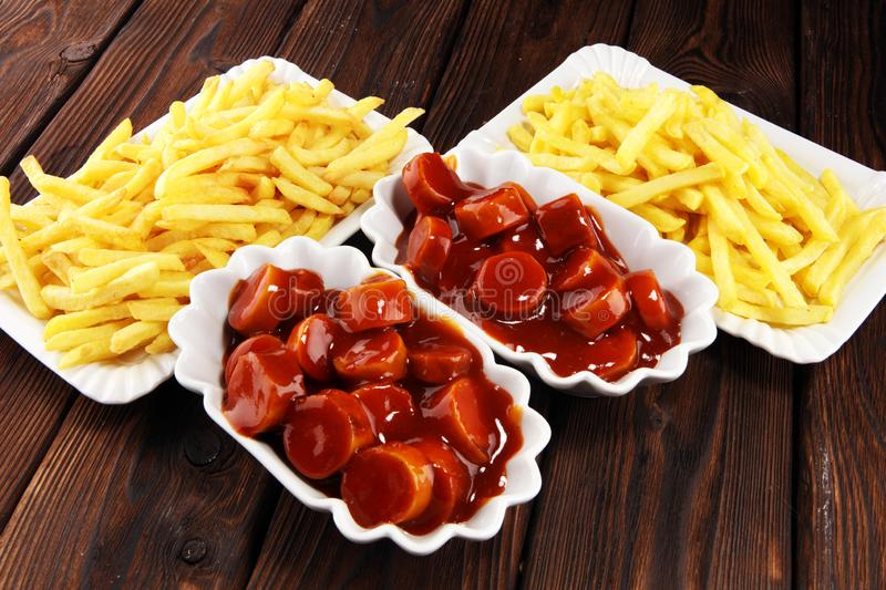 Currywurst with fries. traditional german food with sausages and curry. And fries stock photos