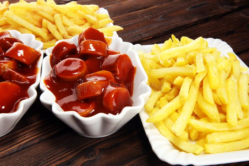 Currywurst with fries. traditional german food with sausages and curry. And fries stock photography