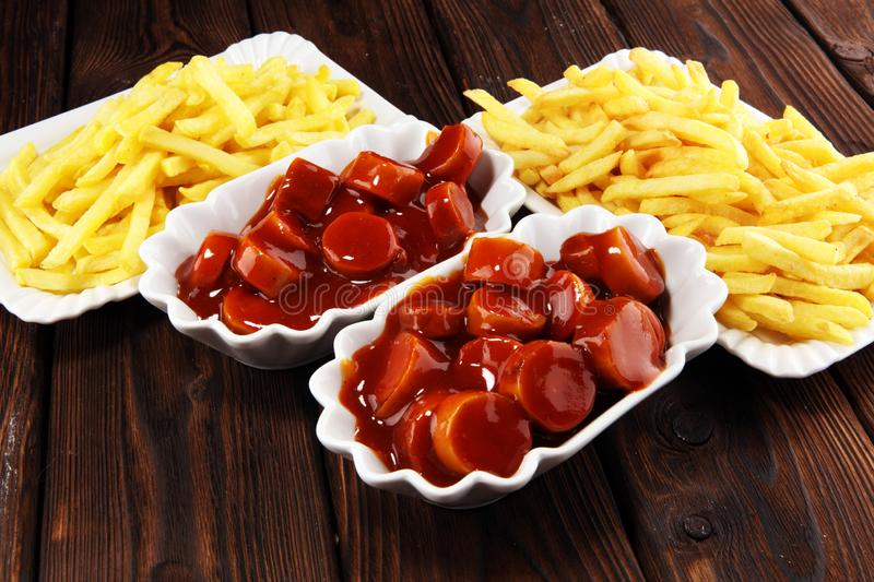 Currywurst with fries. traditional german food with sausages and curry. And fries royalty free stock image