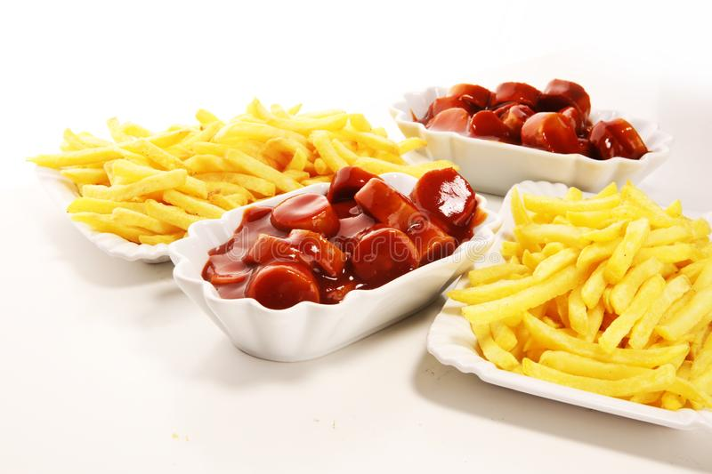Currywurst with fries. traditional german food with sausages and curry. And fries royalty free stock photos
