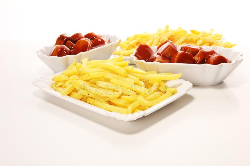 Currywurst with fries. traditional german food with sausages and curry. And fries royalty free stock photography