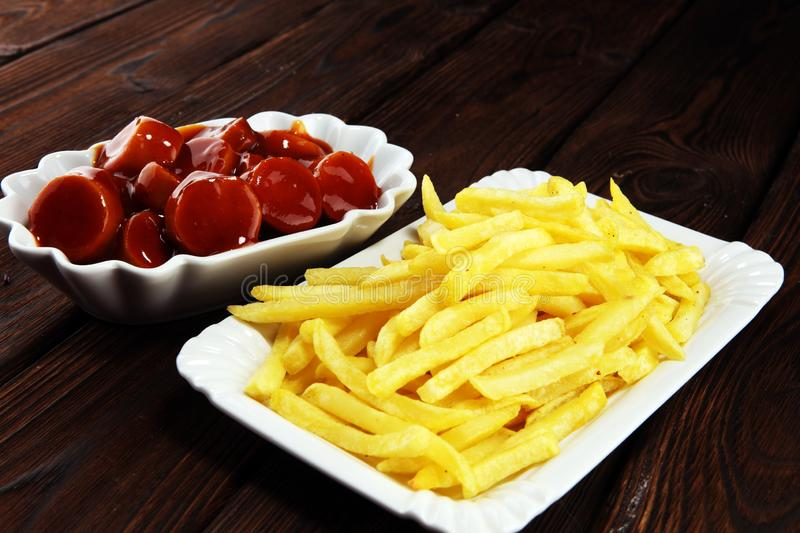 Currywurst with fries. traditional german food with sausages and curry. And fries stock images