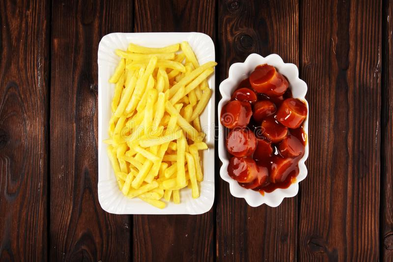 Currywurst with fries. traditional german food with sausages and curry. And fries royalty free stock images
