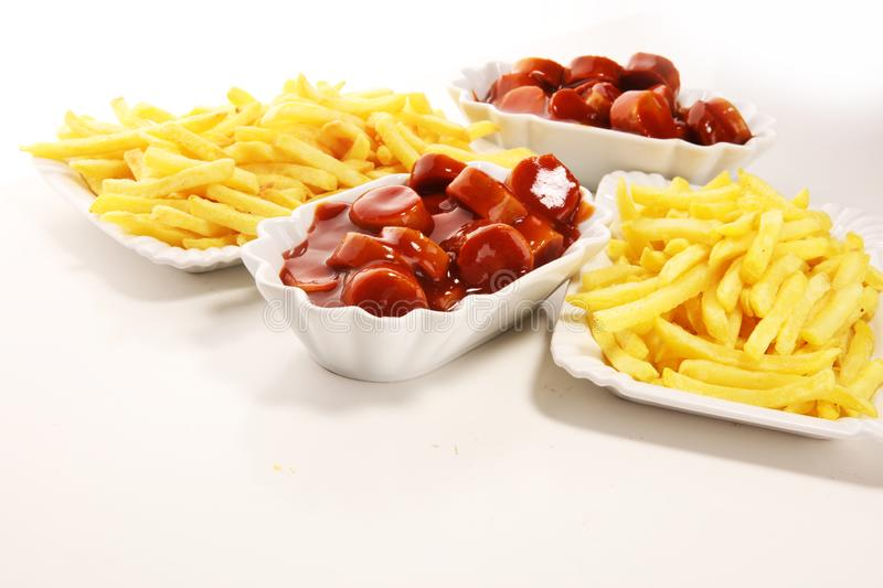 Currywurst with fries. traditional german food with sausages and curry. And fries royalty free stock photo