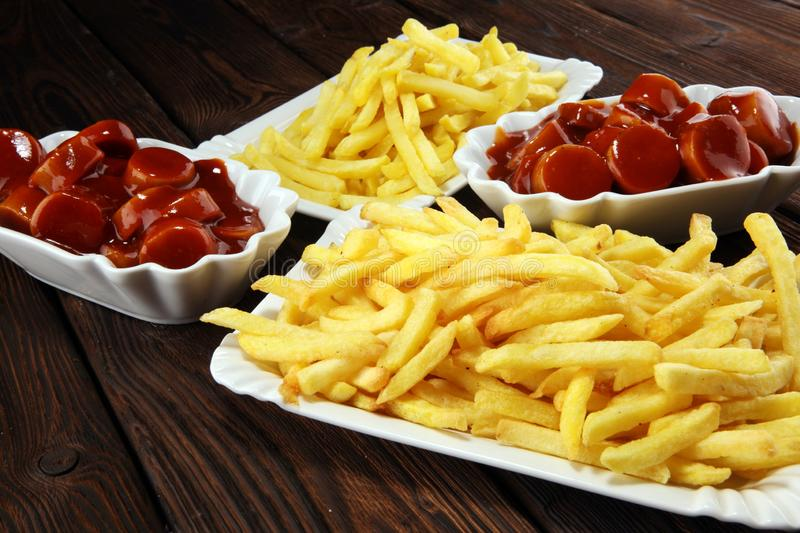Currywurst with fries. traditional german food with sausages and curry. And fries stock image