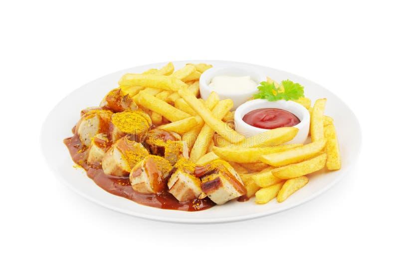 Currywurst met frieten stock foto