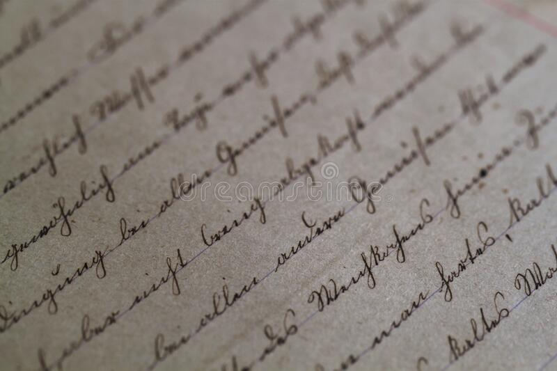 Cursive script on antique paper royalty free stock photography
