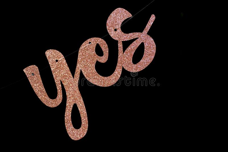Cursive yes sign on black background for agreements, weddings, and other choice concepts in business or personal life.  stock photos