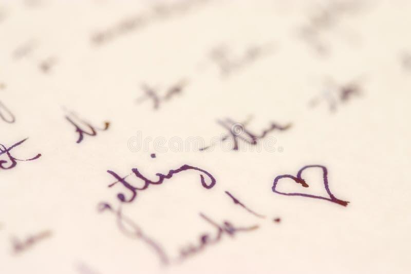 Cursivo con un corazón fotografía de archivo libre de regalías