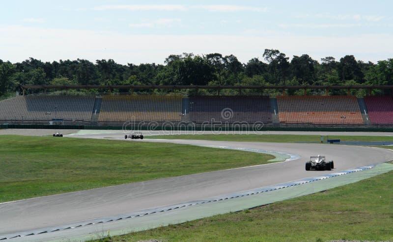 Curso e carros de raça imagens de stock royalty free