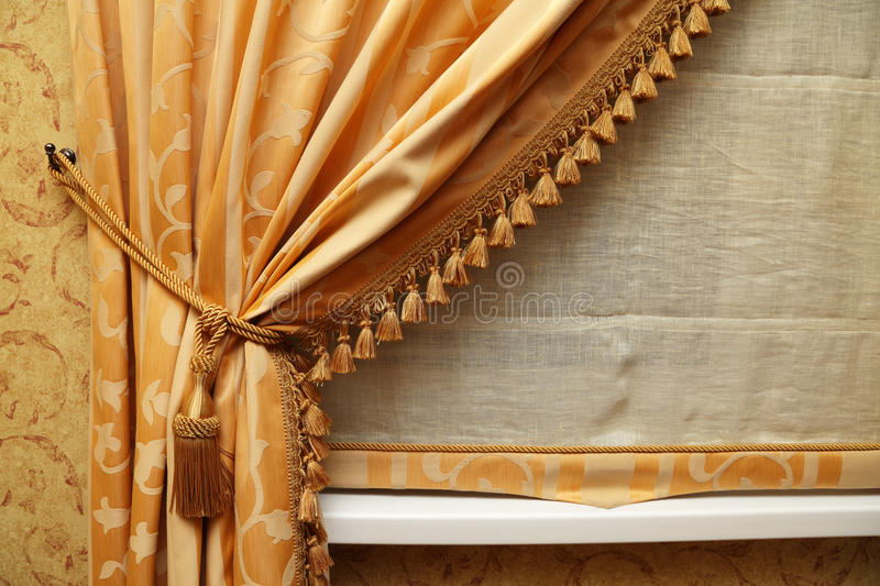 Curtain. Fragment of a beautiful curtain of yellow color royalty free stock images