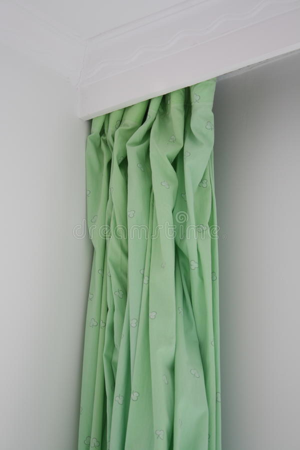 Curtain. Green curtain in a room royalty free stock photos