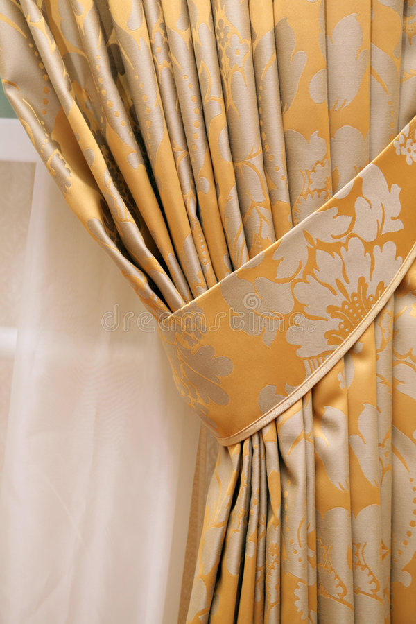 Curtain. Beautiful curtain on edge of a window royalty free stock image