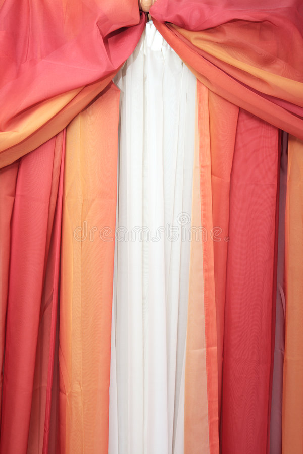 Curtain. In red and orange colors royalty free stock photo