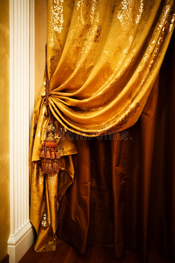 Curtain. With an ornament in the modern apartment royalty free stock photo