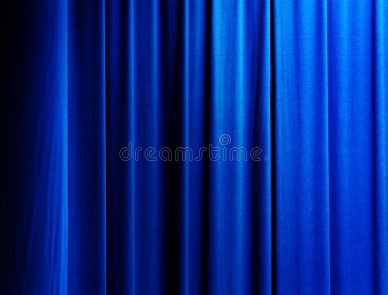 Curtain in blue. Vertical drapes of a curtain with blue color royalty free stock photos