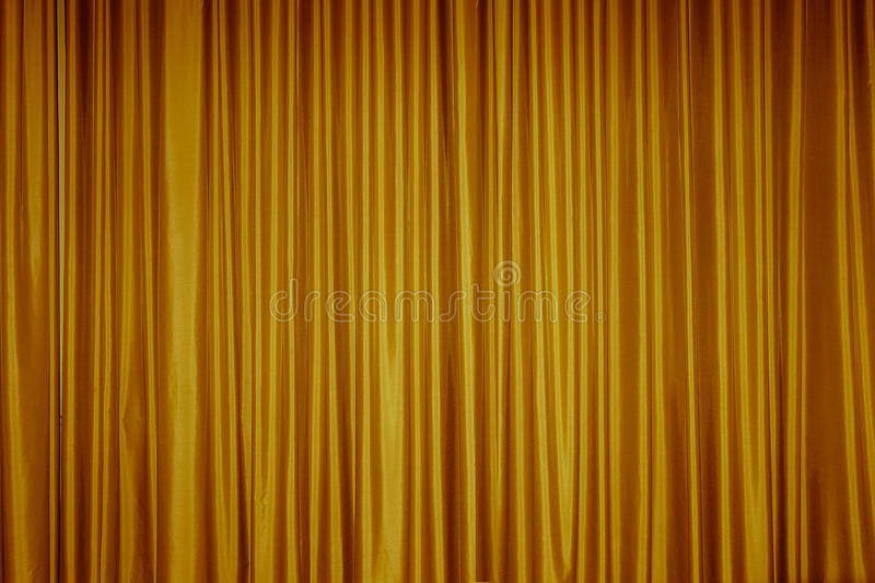 Curtain fabric background texture. Large golden curtain fabric background texture royalty free stock photo
