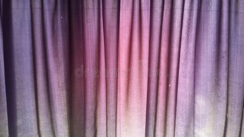 Curtain Fabric. With purple hues stock photography