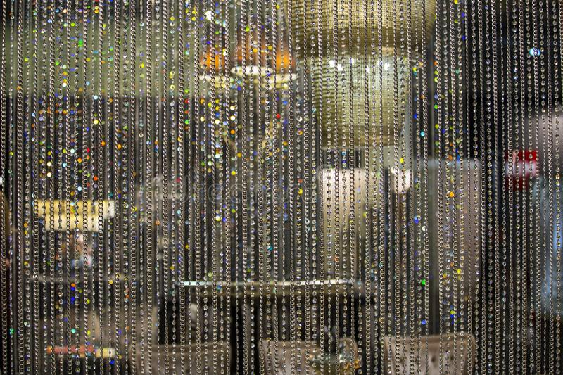 Curtain of glass drops. Crystal beads blind curtain background, concept of Luxury backdrop for wedding celebration Invitation.  royalty free stock images