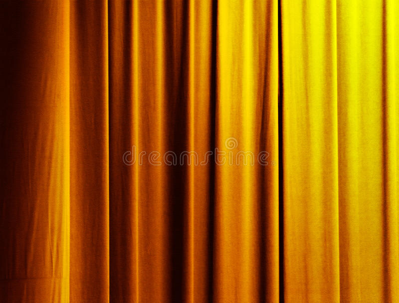 Curtain in gold. Vertical drapes of a curtain with gold color stock image