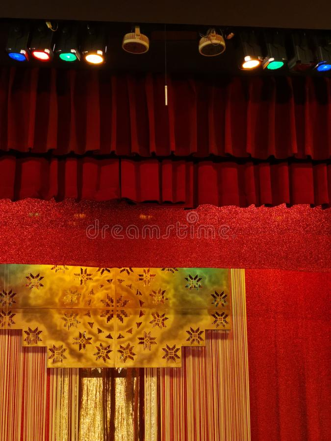 Curtain and light installation on stage royalty free stock photos