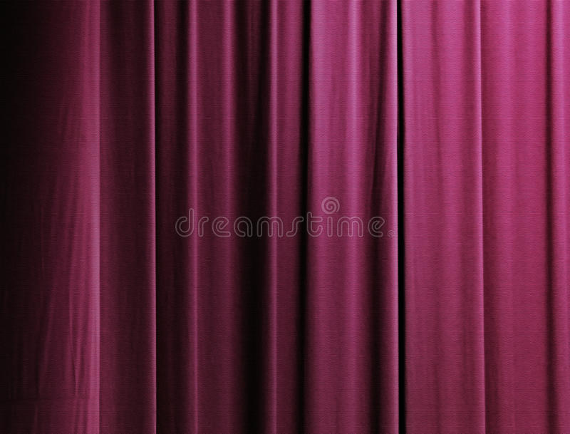 Curtain in red. Vertical drapes of a curtain with wine-red color royalty free stock photography