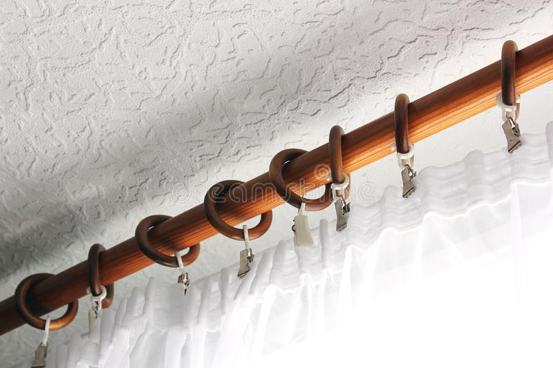Curtain rod with tulle. Background. Tulle on the window royalty free stock images