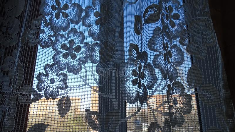 Curtain on the window with lace in retro style. royalty free stock image