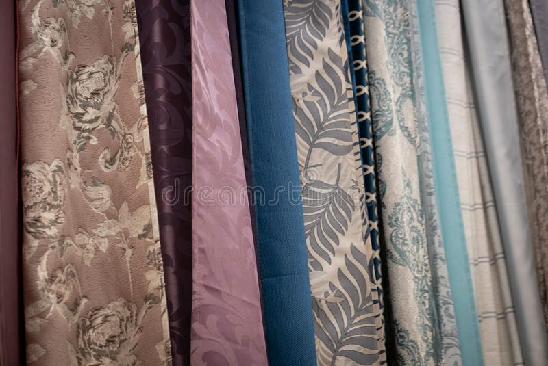 Curtains of different colors and styles in the shop royalty free stock photo