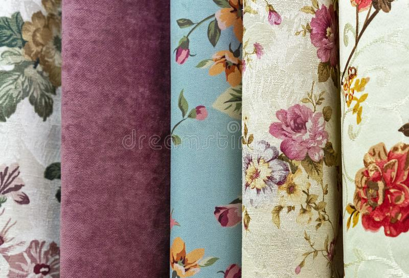 Curtains with floral ornament in the shop window. Fabric with floral pattern royalty free stock photo