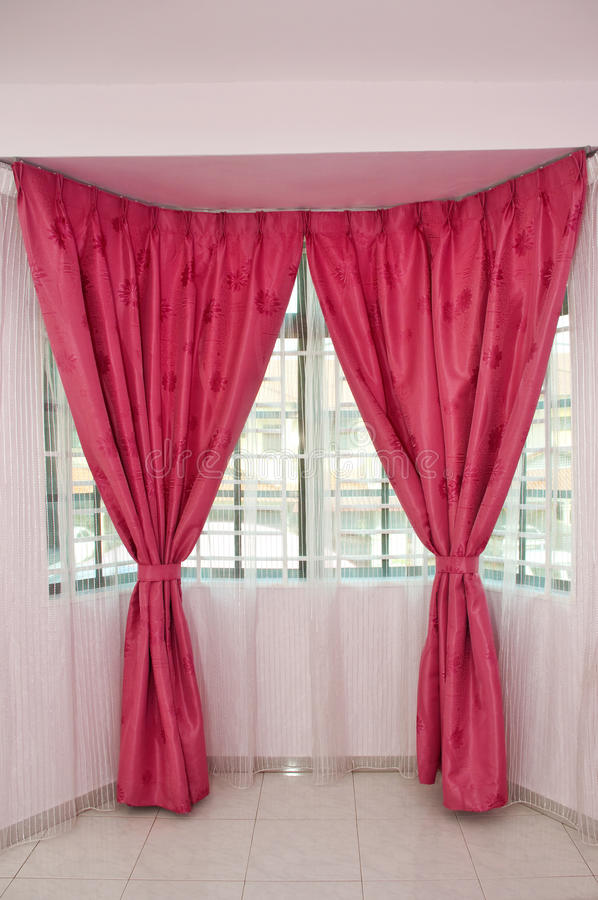 Curtains over window. Home window go to red curtains stock photos