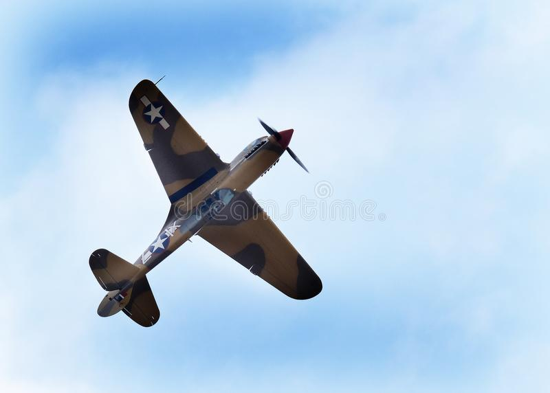 The Curtiss P-40 Warhawk is an American single-engined, single-seat, all-metal fighter and ground-attack aircraft that first flew. Flying Legends air show stock image