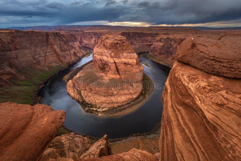 Curva de herradura en la puesta del sol, meandro del río Colorado en la página, Arizona imágenes de archivo libres de regalías