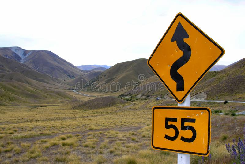 Curva do sinal de estrada imagem de stock royalty free