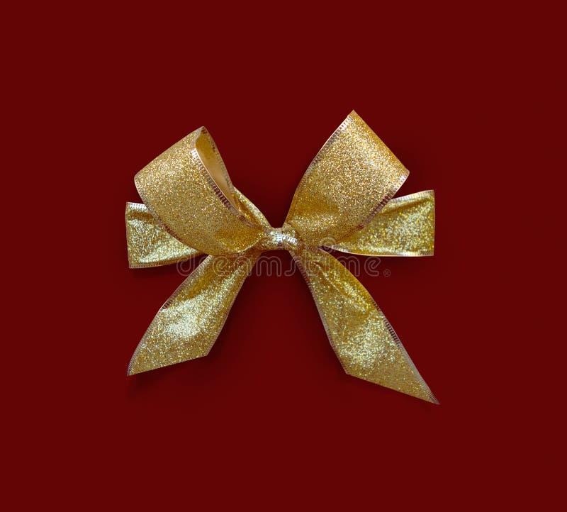 Curva glittery dourada no fundo vermelho fotos de stock royalty free