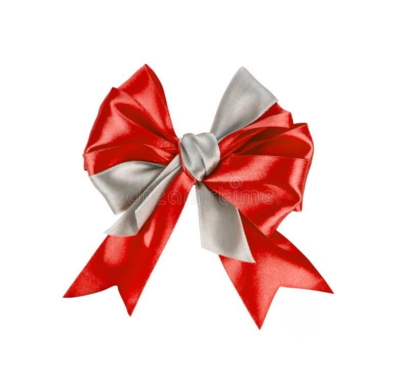 Curva vermelha bonita do presente do cetim fotografia de stock royalty free