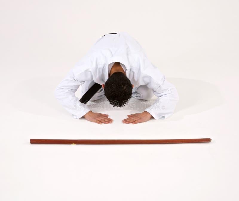 Curvatura do estudante das artes marciais fotos de stock royalty free