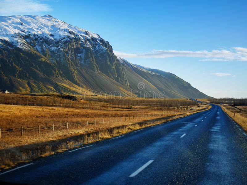 Curve raod to the mountain, Iceland stock photography